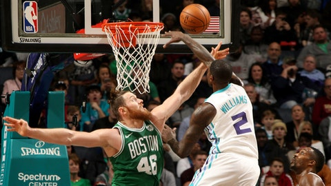CHARLOTTE, NC - DECEMBER 27:  Marvin Williams #2 of the Charlotte Hornets shoots the ball with Aron Baynes #46 of the Boston Celtics on the defense on December 27, 2017 at Spectrum Center in Charlotte, North Carolina. NOTE TO USER: User expressly acknowledges and agrees that, by downloading and or using this photograph, User is consenting to the terms and conditions of the Getty Images License Agreement.  Mandatory Copyright Notice:  Copyright 2017 NBAE (Photo by Brock Williams-Smith/NBAE via Getty Images)
