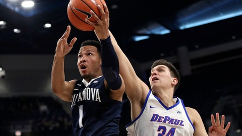 Villanova's Jalen Brunson, left, goes to the basket against DePaul's Marin Maric (34) during the second half of an NCAA college basketball game Wednesday, Dec. 27, 2017, in Chicago. (AP Photo/Jim Young)