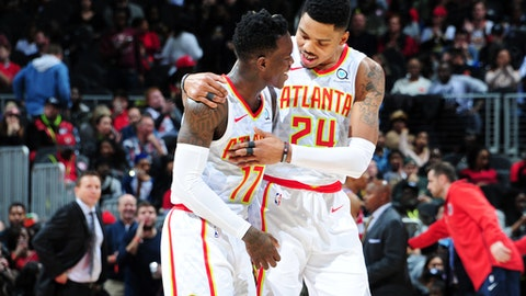 ATLANTA, GA - DECEMBER 27: Dennis Schroder #17 and Kent Bazemore #24 of the Atlanta Hawks talk during the game against the Washington Wizards on December 27, 2017 at Philips Arena in Atlanta, Georgia. NOTE TO USER: User expressly acknowledges and agrees that, by downloading and/or using this Photograph, user is consenting to the terms and conditions of the Getty Images License Agreement. Mandatory Copyright Notice: Copyright 2017 NBAE (Photo by Scott Cunningham/NBAE via Getty Images)