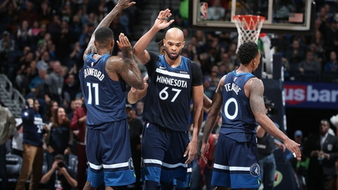 MINNEAPOLIS, MN -  DECEMBER 27:  Taj Gibson #67 of the Minnesota Timberwolves shakes hands with his teammates during the game against the Denver Nuggets on December 27, 2017 at Target Center in Minneapolis, Minnesota. NOTE TO USER: User expressly acknowledges and agrees that, by downloading and or using this Photograph, user is consenting to the terms and conditions of the Getty Images License Agreement. Mandatory Copyright Notice: Copyright 2017 NBAE (Photo by David Sherman/NBAE via Getty Images)