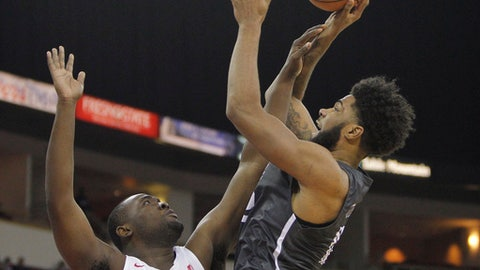 Nevada's Elijah Foster goes up for a shot against Fresno State's Terrell Carter II during the first half of an NCAA college basketball game in Fresno, Calif., Wednesday, Dec. 27, 2017. (AP Photo/Gary Kazanjian)