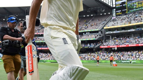 England's Alastair Cook walks off the ground not out at stumps on the third day of their Ashes cricket test match against Australia in Melbourne, Australia, Thursday, Dec. 28, 2017. (AP Photo/Andy Brownbill)