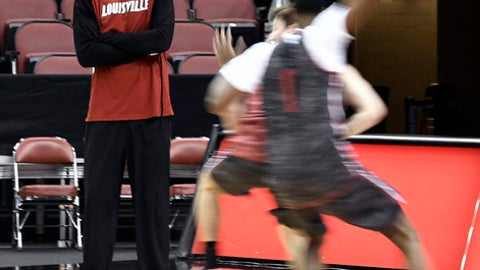 """Louisville interim coach David Padgett watches his team practice for an upcoming game against Grand Canyon, Friday, Dec. 22, 2017, in Louisville, Ky. Being considered even keeled and laid back doesn't mean he's silent, and he's frequently pushing players to """"Push It, Push It, Push It"""" or """"Finish, Finish"""" before saying """"Good, Good, Good"""" and moving on to another area of the floor. (AP Photo/Timothy D. Easley)"""