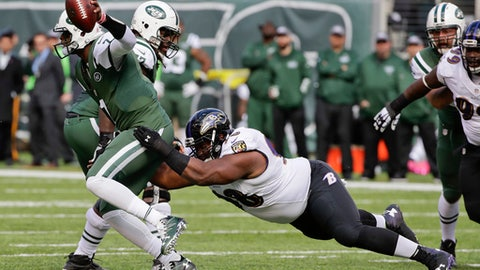 "File-This Oct. 23, 2016, file photo shows Baltimore Ravens nose tackle Brandon Williams (98) sacking New York Jets quarterback Geno Smith (7) during the first quarter of an NFL football game in East Rutherford, N.J. The Baltimore Ravens understand completely the significance of Sunday's regular season finale against Cincinnati. ""It pretty much lets us know if we're going to be on the couch next week or on the field,"" Williams said. ""Definitely don't want to be on the couch."" Beat the Bengals (6-9), and the Ravens (9-6) end a two-year hiatus from the postseason. Lose, and Baltimore will need help to get in.(AP Photo/Frank Franklin II, File)"