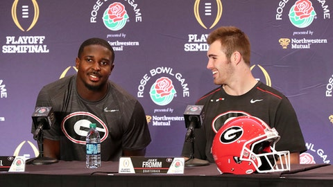 Georgia tailback Sony Michel and quarterback Jake Fromm share a laugh during press conferences for the Rose Bowl Game on Thursday, Dec. 28, 2017, in Los Angeles. (Curtis Compton/Atlanta Journal-Constitution via AP)