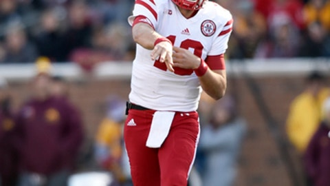 "File- This Nov. 11, 2017, file photo shows Nebraska quarterback Tanner Lee (13) passing the ball against Minnesota during the first quarter of an NCAA college football game on , in Minneapolis. Lee is forfeiting his final year of eligibility and will enter the NFL draft. Lee tweeted Thursday, Dec. 28, 2017, ""after weeks of prayer and consideration with my family, I've decided to enter the NFL draft and pursue an opportunity that I feel is the best for myself and my family at this time."" (AP Photo/Hannah Foslien, File)"