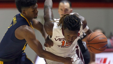 Chris Clarke (15) of Virginia Tech drives past North Carolina A&T's Kameron Langley (4) in the second half of an NCAA college basketball game in Blacksburg Va. Thursday Dec. 28 2017. (Matt Gentry/The Roanoke Times via AP)