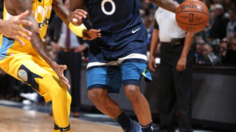 MINNEAPOLIS, MN -  DECEMBER 27:  Jeff Teague #0 of the Minnesota Timberwolves handles the ball against Will Barton #5 of the Denver Nuggets on December 27, 2017 at Target Center in Minneapolis, Minnesota. NOTE TO USER: User expressly acknowledges and agrees that, by downloading and or using this Photograph, user is consenting to the terms and conditions of the Getty Images License Agreement. Mandatory Copyright Notice: Copyright 2017 NBAE (Photo by David Sherman/NBAE via Getty Images)