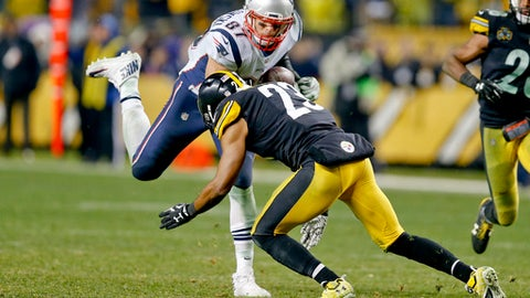 "File-This Dec. 17, 2017, file photo shows New England Patriots tight end Rob Gronkowski (87) playing against the Pittsburgh Steelers, in an NFL football game, in Pittsburgh. BEST GAME: Patriots 27, Steelers 24. It was ballyhooed for weeks, and in most ways it lived up to the billing. Seesaw contest matching the AFC's best teams (by far), filled with big plays and controversy, don't ask Steelers fans about the ""catch rule.""(AP Photo/Keith Srakocic, File)"