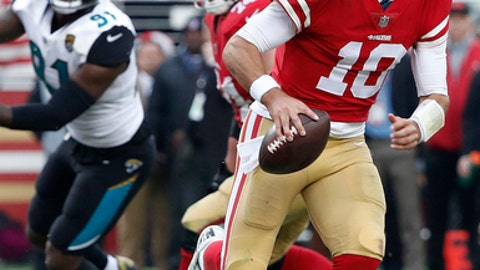 "File-This Dec. 24, 2017, file photo shows San Francisco 49ers quarterback Jimmy Garoppolo (10) against the Jacksonville Jaguars during the second half of an NFL football game in Santa Clara, Calif. ""You try to every week say that you're facing a faceless opponent,'' said Garoppolo, who had been Tom Brady's backup with the Patriots until being traded to the 49ers on Oct. 31. ""No matter who it is you want to have the same mindset. No matter what type of game it is, first game of the season, last game of the season. I think we've done that pretty well the last couple of weeks; just coming in, preparing every day, practicing hard, going through the little critiques of certain plays and I think if we keep going that we'll be good on Sunday."" (AP Photo/Tony Avelar, File)"