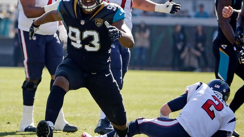 File- This Dec. 17, 2017, file photo shows Jacksonville Jaguars defensive lineman Calais Campbell (93) celebrating after sacking Houston Texans quarterback T.J. Yates (2) during the first half of an NFL football game in Jacksonville, Fla. The Jacksonville Jaguars intend to play and sound eager for a little payback against the only divisional team to beat the AFC South champs. The Tennessee Titans know a win clinches an elusive postseason berth for themselves in a game that could be a playoff preview.  (AP Photo/Stephen B. Morton, File)