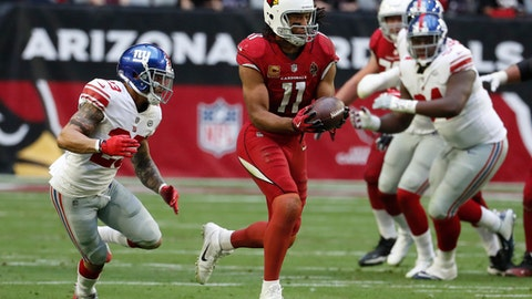 File- This Dec. 24, 2017, file photo shows Arizona Cardinals wide receiver Larry Fitzgerald (11) during an NFL football game against the New York Giants in Glendale, Ariz.  Fitzgerald might well be the most popular athlete in the history of the state of Arizona. The wide receiver's resume is packed with Hall of Fame-caliber statistics accumulated over 14 seasons with the same Cardinals team that drafted him third overall in 2004. Add to that his easy-going personality combined with a remarkable durability _ he's missed six games of his 208 games since joining the league. A year ago, Fitzgerald and the Giants' Eli Manning shared the NFL man of the year award his work off the field. And impressively, at age 34, on the field he's still playing at it at a high level, all while staying mum on whether he will return for another season. (AP Photo/Rick Scuteri, File)