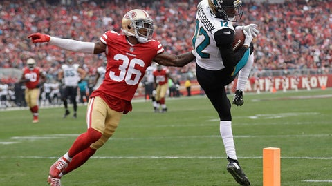 FILE - In this Dec. 24, 2017, file photo, Jacksonville Jaguars wide receiver Dede Westbrook (12) catches a pass in front of San Francisco 49ers cornerback Dontae Johnson (36) during the first half of an NFL football game in Santa Clara, Calif. Setbacks have left rookies Keelan Cole and Westbrook as the team's go-to receivers. (AP Photo/Marcio Jose Sanchez, File)