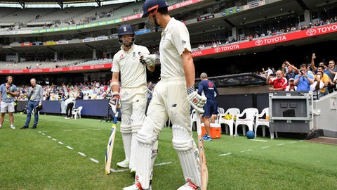 England's Alastair Cook, right, and James Anderson prepare to run out against Australia at the start of the fourth day of their Ashes cricket test match in Melbourne, Australia, Friday, Dec. 29, 2017. (AP Photo/Andy Brownbill)