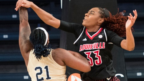 Louisville forward Bionca Dunham (33) fouls Georgia Tech forward Zaire O'Neil during the first half of an NCAA college basketball game Thursday, Dec. 28, 2017, in Atlanta. (AP Photo/John Amis)