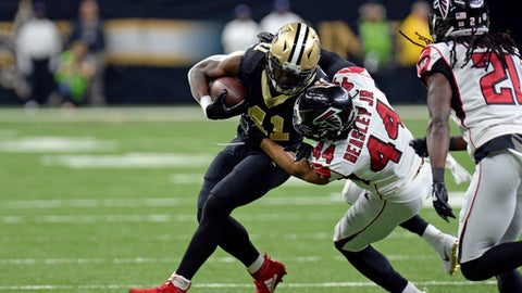 FILE - In this Dec. 24, 2017, file photo, Atlanta Falcons outside linebacker Vic Beasley (44) tries to tackle New Orleans Saints running back Alvin Kamara (41) in the first half of an NFL football game in New Orleans. Kamara says the NFL has fined him $6,079 for wearing Christmas-themed red cleats with white trim during last Sunday's victory over Atlanta. (AP Photo/Bill Feig, File)