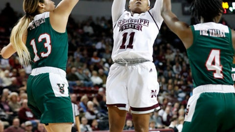 Mississippi State guard Roshunda Johnson (11) shoots past Mississippi Valley State guards Sydney Floyd (13) and Kristy Parker (4) during the first half of an NCAA college basketball game in Starkville, Miss., Thursday, Dec. 28, 2017. (AP Photo by Rogelio V. Solis)