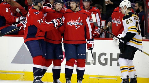 Washington Capitals defenseman John Carlson, left; defenseman Christian Djoos, from Sweden; and center Lars Eller (20), from Denmark, celebrate Eller's goal as Boston Bruins center Danton Heinen (43) skates past during the second period of an NHL hockey game Thursday, Dec. 28, 2017, in Washington. (AP Photo/Alex Brandon)