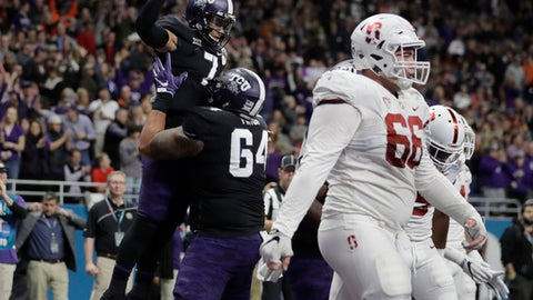 TCU quarterback Kenny Hill (7) is lifted by teammate Matt Pryor (64) after he ran for a touchdown against Stanford during the first half of the Alamo Bowl NCAA college football game, Thursday, Dec. 28, 2017, in San Antonio. (AP Photo/Eric Gay)