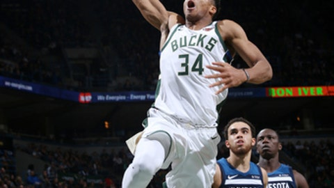 Milwaukee, WI - DECEMBER 28: Giannis Antetokounmpo #34 of the Milwaukee Bucks drives to the basket against the Minnesota Timberwolves on December 28, 2017 at the BMO Harris Bradley Center in Milwaukee, Wisconsin. NOTE TO USER: User expressly acknowledges and agrees that, by downloading and or using this Photograph, user is consenting to the terms and conditions of the Getty Images License Agreement. Mandatory Copyright Notice: Copyright 2017 NBAE (Photo by Gary Dineen/NBAE via Getty Images)