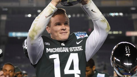 Michigan State quarterback Brian Lewerke (14) holds up the offensive MVP trophy after Michigan State defeated Washington State 42-17 in the Holiday Bowl NCAA college football game Thursday, Dec. 28, 2017, in San Diego. (AP Photo/Denis Poroy)