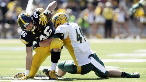 Iowa tight end George Kittle (46) is tackled by North Dakota State linebacker Nick DeLuca, right, after making a reception during the first half of an NCAA college football game, Saturday, Sept. 17, 2016, in Iowa City, Iowa. North Dakota State won 23-21. (AP Photo/Charlie Neibergall)