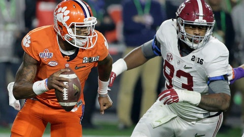 FILE - In this Jan. 11, 2016, file photo, Clemson quarterback Deshaun Watson, left, tries to get away from Alabama's Jonathan Allen during the first half of the NCAA college football playoff championship game in Glendale, Ariz. Clemson and Alabama will meet Monday in the College Football Playoff for the third straight year when they square off in the Sugar Bowl. After finishing third in the Heisman voting, Watson passed for 405 yards and four touchdowns against 'Bama while running for 73 yards in the 2016 game. (AP Photo/Chris Carlson, File)