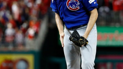 Chicago Cubs relief pitcher Wade Davis reacts after the final out as the Cubs beat the Washington Nationals 9-8 to to win baseball's National League Division Series, at Nationals Park, early Friday, Oct. 13, 2017, in Washington (AP Photo/Alex Brandon)