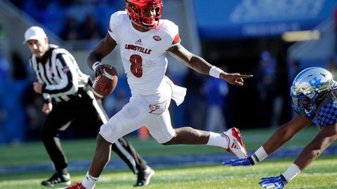 FILE - In this Nov. 25, 2017, file photo, Louisville quarterback Lamar Jackson (8) scrambles past Kentucky defensive tackle Kordell Looney during the second half of an NCAA college football game in Lexington, Ky. Jackson never even considered sitting out the TaxSlayer Bowl. The 2016 Heisman Trophy winner said Friday, Dec. 29, that he wanted to play because of his teammates. (AP Photo/David Stephenson, File)