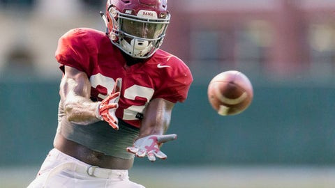 FILE - In this Aug. 9, 2017, file photo, Alabama linebacker Rashaan Evans (32) works through drills during football practice at the Thomas-Drew Practice Fields in Tuscaloosa, Ala. Evans doesn't downplay how disruptive injuries have been to the Crimson Tide linebacker corps. He says the injuries have affected chemistry and schemes. (Vasha Hunt/AL.com via AP, File)
