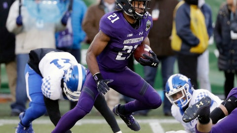 Northwestern running back Justin Jackson (21) carries the ball against Kentucky in the first half of the Music City Bowl NCAA college football game Friday, Dec. 29, 2017, in Nashville, Tenn. (AP Photo/Mark Humphrey)