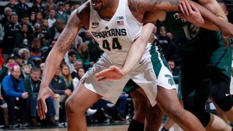 Michigan State's Nick Ward (44) and Cleveland State's Stefan Kenic (13) battle for the ball during the first half of an NCAA college basketball game, Friday, Dec. 29, 2017, in East Lansing, Mich. (AP Photo/Al Goldis)