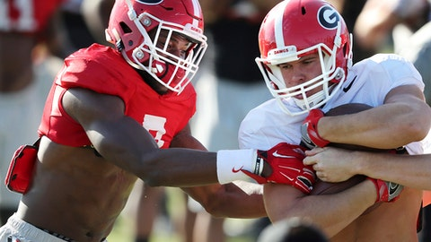 Georgia linebacker Lorenzo Carter works to rip the ball away from tight end Charlie Woerner during team practice for the Rose Bowl at the StubHub Center in Carson, Calif., Friday, Dec. 29, 2017. (Curtis Compton/Atlanta Journal-Constitution via AP)