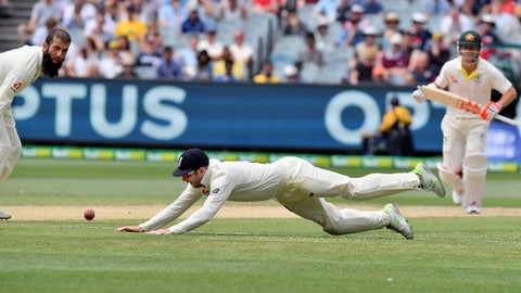 England's Mark Stoneman dives to field against Australia during the fifth day of their Ashes cricket test match in Melbourne, Australia, Saturday, Dec. 30, 2017. (AP Photo/Andy Brownbill)