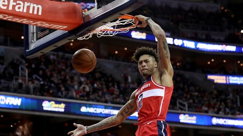 WASHINGTON, DC - DECEMBER 29: Kelly Oubre Jr. #12 of the Washington Wizards dunks the ball against the Houston Rockets in the second half at Capital One Arena on December 29, 2017 in Washington, DC. NOTE TO USER: User expressly acknowledges and agrees that, by downloading and or using this photograph, User is consenting to the terms and conditions of the Getty Images License Agreement. (Photo by Rob Carr/Getty Images)