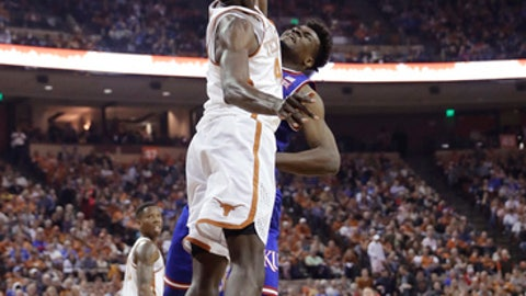 Texas forward Mohamed Bamba (4) blocks a shot by Kansas center Udoka Azubuike (35) during the first half of an NCAA college basketball game Friday, Dec. 29, 2017, in Austin, Texas. (AP Photo/Eric Gay)