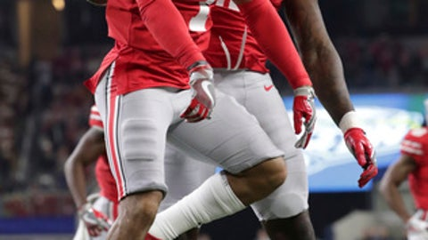Ohio State safety Damon Webb (7) celebrates his touchdown with teammate Jalyn Holmes (11) during the first half of the Cotton Bowl NCAA college football game against Southern California in Arlington, Texas, Friday, Dec. 29, 2017. (AP Photo/LM Otero)