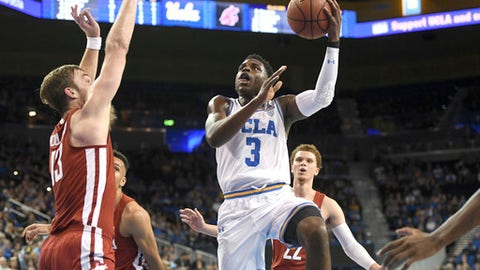 UCLA's Aaron Holiday (3) drives to the basket against Washington State during the first half of an NCAA college basketball game Friday, Dec. 29, 2017, in Los Angeles. (AP Photo/Michael Owen Baker)