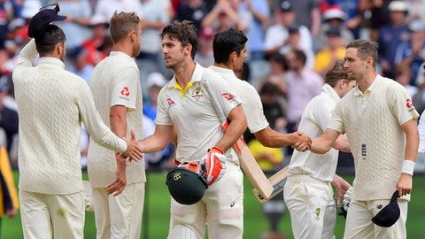 Australia's Mitchell Marsh, third left, shakes hands with England players at the end of their Ashes cricket test match against Australia in Melbourne, Australia, Saturday, Dec. 30, 2017. The match is a draw. (AP Photo/Andy Brownbill)