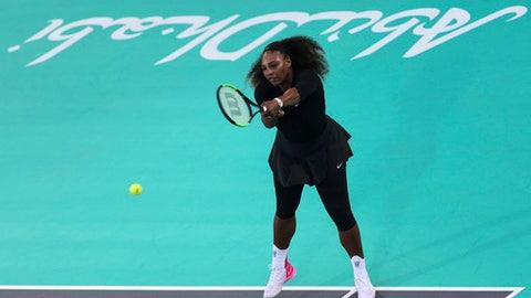 Serena Williams, of the U.S., returns the ball to Jelena Ostapenko, of Latvia, during the final day of the Mubadala World Tennis Championship in Abu Dhabi, United Arab Emirates, Saturday, Dec. 30, 2017. (AP Photo/Kamran Jebreili)