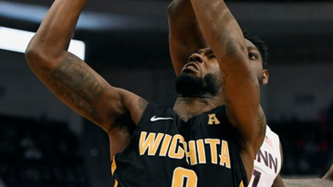 Wichita State's Rashard Kelly shoots as Connecticut's Mamadou Diarra, back defends during the first half of an NCAA college basketball game, Saturday, Dec. 30, 2017, in Hartford, Conn. (AP Photo/Jessica Hill)