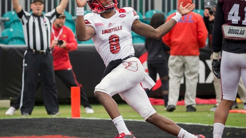 Louisville quarterback Lamar Jackson (8) celebrates a touchdown during the first half of the TaxSlayer Bowl NCAA college football game against the Mississippi State, Saturday, Dec. 30, 2017, in Jacksonville, Fla. (AP Photo/Stephen B. Morton)