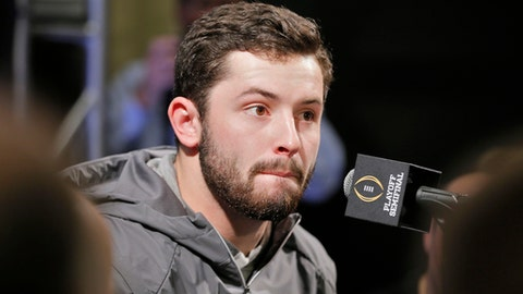 Oklahoma quarterback Baker Mayfield answers questions during his team's media appearance, Saturday, Dec. 30, 2017. Mayfield participated in team media day activities after arriving late to the event. He reportedly has been recovering from the flu over Christmas break. He missed the trip to Disneyland on Wednesday with the illness and another event on Friday. Oklahoma plays Georgia in an NCAA college football semifinal playoff game at the Rose Bowl on Monday, Jan. 1, 2018. (Bob Andres/Atlanta Journal-Constitution via AP)