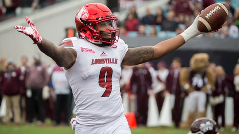 Louisville wide receiver Jaylen Smith (9) celebrates a touchdown during the first half of the TaxSlayer Bowl NCAA college football game Mississippi State, Saturday, Dec. 30, 2017, in Jacksonville, Fla. (AP Photo/Stephen B. Morton)