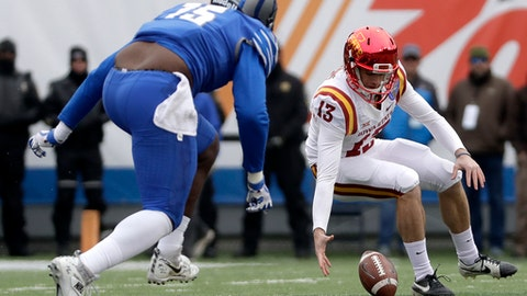 Iowa State punter Colin Downing (13) recovers a fumbled snap as Memphis defensive lineman Christian Johnson (15) closes in during the first half of the Liberty Bowl NCAA college football game, Saturday, Dec. 30, 2017, in Memphis, Tenn. (AP Photo/Mark Humphrey)