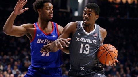 Xavier forward Naji Marshall (13) drives to the basket against DePaul guard Eli Cain (11) during the first half of an NCAA college basketball game, Saturday Dec. 30, 2017, in Cincinnati. (AP Photo/Gary Landers)