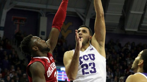 Oklahoma forward Khadeem Lattin (3) tries to defend as TCU forward Ahmed Hamdy-Mohamed (23) shoots during the first half of an NCAA college basketball game, Saturday, Dec. 30, 2017. (AP Photo/ Richard W. Rodriguez)