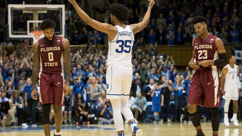 Duke's Marvin Bagley III (35) celebrates as Florida State's Phil Cofer (0) and M.J. Walker (23) walk off the court in the final seconds of an NCAA college basketball game in Durham, N.C., Saturday, Dec. 30, 2017. (AP Photo/Ben McKeown)