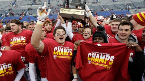 Iowa State players celebrate with their trophy after beating Memphis in the Liberty Bowl NCAA college football game, Saturday, Dec. 30, 2017, in Memphis, Tenn. Iowa State won 21-20. (AP Photo/Mark Humphrey)