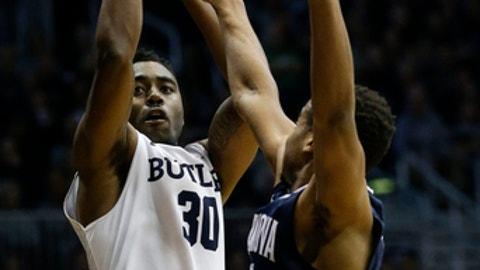 Butler forward Kelan Martin, left, shoots over Villanova guard Phil Boothin the first half of an NCAA college basketball game in Indianapolis, Saturday, Dec. 30, 2017. (AP Photo/AJ Mast)